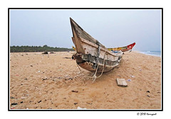 wooden boat (harrypwt) Tags: harrypwt africa afrika togo lome canons95 s95 paintinglike boat sand coastal sea water borders framed