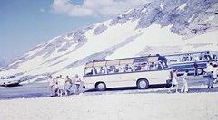 Tour Busses (zeesstof) Tags: geo:lat=4708088108 geo:lon=1284269546 geotagged zeesstofsmom kodachrome film 35mmslidefilm mamiya 1969 summerholiday mountains alps austrianalps triptothegrossglockner snow snowinsummer