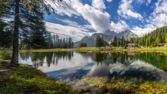 Lake Misurina (Sworldguy) Tags: a73 camera sonya73 italia reflections skyscape clouds mountains scenic forest dolomites chalet cortinadampezzo lakemisurina tourism travelphotography trail outdoors landscape sunny