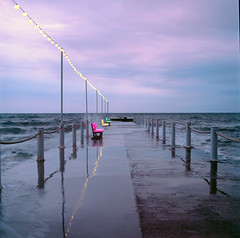 Pier in the rain (Vsevolod Vlasenko) Tags: hasselblad sunset pier blacksea hasselblad501c sky rain mformat 120 analog filmnegative minoltadimagescanmultipro planar zeiss carlzeiss clouds travel nature evening