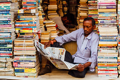 A Man of Many Words, Varanasi India (AdamCohn) Tags: adam cohn ganga ganges india uttarpradesh varanasi books man men newspaper reading shop store streetphotographer streetphotography vendor wwwadamcohncom adamcohn bookstore bookshop