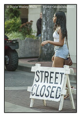 No!  Not True!  Although there Are Sensory Misers Who Want to Close the Streets so that You Cannot Be Seen, You Are Still Free to Make Your Way, and I Am Still Free to Admire Your Beauty (Doyle Wesley Walls) Tags: 0380 girl woman female shorts whitetop denim jeans beauty legs sandals longhair streetphotography beautiful sexy doylewesleywalls pedestrian text words sign