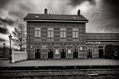 Train To Nowhere (Alfred Grupstra) Tags: blackandwhite architecture old history buildingexterior oldfashioned builtstructure house outdoors facade cultures urbanscene retrostyled nopeople window england street europe monochrome stayion