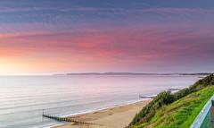 Purbeck Pinks (nicklucas2) Tags: seascape beach boscombe bournemouth dorset sea seaside sand pier sunrise cloud