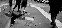 The cup. (Baz 120) Tags: candid candidstreet candidportrait city contrast street streetphotography streetphoto streetcandid streetportrait strangers rome roma ricohgrii europe women monochrome monotone mono noiretblanc bw blackandwhite urban life portrait people italy italia grittystreetphotography faces decisivemoment