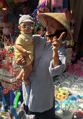 A Day at the Market (cowyeow) Tags: hanoi vietnam asia asian street urban city people woman cute smile vietnamese vietnamesewoman portrait family baby sunglasses funny