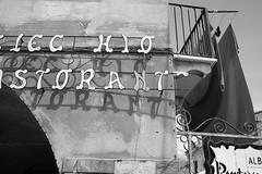 Noli, Liguria (fabiolug) Tags: sign letters lettering restaurant ristorante wall building architecure light shadow shadows noli liguria ligury italy italia leicammonochrom mmonochrom monochrom leicamonochrom leica leicam rangefinder blackandwhite blackwhite bw monochrome biancoenero voigtlandernoktonclassic35mmf14 voigtlandernokton35mmf14 voigtlander35mmf14 35mm voigtlander design street streetphotography