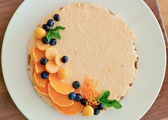 Vegan orange cheesecake, with an almond-coconut crust, decorated with cape gooseberries, blueberries and slices of tangerine (gamze avci) Tags: glutenfree orange cheesecake vegancheesecake plantbased vegan