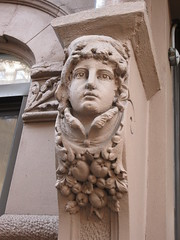Woman with High Collar Gargoyle Next to Door Way 4685 (Brechtbug) Tags: woman with high collar gargoyle above door front exterior building entrance new york city near 9th ave west 21st street nyc 2018 gargoyles statue sculpture man portrait art downtown stone terracotta tile artist portraits 20s area w women slope low nose