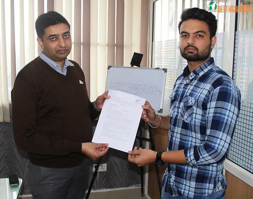 Mr. Gurvinder Singh (Director of West Highlander) handing over New Zealand Student Visa to Robinjit Singh Gill