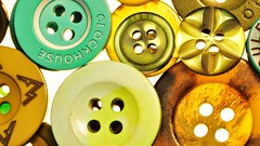 greenish buttons (norbert.wegner) Tags: macromondays green equipment backgrounds closeup plastic spool pattern sewing multicolored industry technology nopeople colors blue singleobject groupofobjects circle yellow red partof button