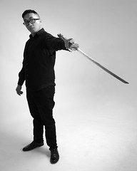 Swordsman (Sean Anderson Media) Tags: portrait pose sword swordsman model malemodel style fashion fashionphotography sonya7sii seamlessbackdrop blackandwhite monochrome canonef24105mmf4 fotodiox factorprizmo studioshoot studiolight