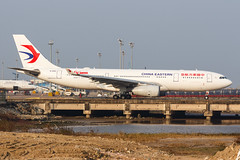 """CHINA EASTERN A330-243 B-5942 """"60th Anniversary"""" 0042 (A.S. Kevin N.V.M.M. Chung) Tags: aviation aircraft aeroplane airport airlines airbus plane spotting macauinternationalairport mfm taxiway a330200 a330 chinaeastern speciallivery"""