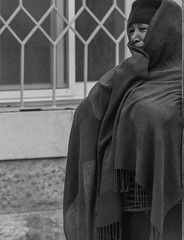 """And when Rachel saw that she bore Jacob no children, Rachel envied her sister; and she said unto Jacob: 'Give me children, or else I die.' "" (ybiberman) Tags: israel jerusalem ethiopianchurch ethiopiancathedral nun funeral portrait candid streetphotography people veil crying tears hat bw"