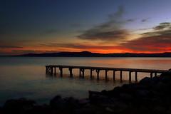 The pier at sunset (annalisabianchetti) Tags: sunset tramonto lake lagodigarda pier pontile clouds nuvole paesaggio landscape beautiful beauty