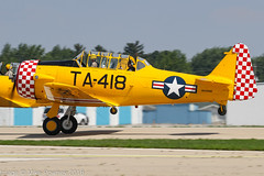 N418BB - 1945 build North American AT-6D Texan, rolling for departure on Runway 27 at Oshkosh during Airventure 2018 (egcc) Tags: 8811836 at6d airventure airventure2018 brunetti eaa harvard hood kosh lightroom mm53418 n1364n n418bb northamerican osh oshkosh ta418 texan usairforce usaf warbird53418