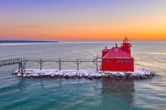 Sturgeon Bay Lighthouse (Daniel000000) Tags: sturgeon bay wisconsin wi lighthouse sunrise sky clouds water lake michigan great lakes pier red orange green morning adventure explore dji mavic 2 pro drone reflection snow ice winter cold art old new colors colorful white light sun sunshine sunlight