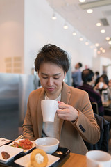 Young man drinking coffee at lunch (Apricot Cafe) Tags: img82448 adultsonly asia asianandindianethnicities cafe fashionable healthyeating japan japaneseethnicity smartcasual tamronsp35mmf18divcusdmodelf012 tokyojapan bright business businesscasual candid city citylife coffee coffeecup colorimage confidence day drinking foodanddrink happiness indoors jacket lifestyles lunch men oneyoungmanonly onlyjapanese people photography relaxing restaurant sitting success waistup youngadult