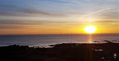 Newbiggin-By-The-Sea - Sunrise Panorama (P) (Gilli8888) Tags: cameraphone samsung s7 newbigginbythesea newbiggin northeast coast seaside northumberland sunrise shoreline seascape sun sky water rocks beach turbines windturbines panorama colour northsea silhouette silhouettephotography