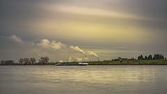 Going northwards like the Rhine river (Of Light & Lenses) Tags: steinheilcassars2850mm sixties rhein rhine deutschland boat schiff binnenschifffahrt cloudysky colorfulsky steam industry fluss vintagelens