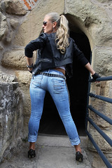 Anna 146 (The Booted Cat) Tags: sexy blonde model girl tight blue jeans leather jacket sunglasses gloves spike heels highheels pumps