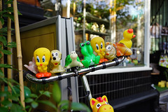 Handlebar character collection (Eric Flexyourhead) Tags: amsterdam netherlands holland nederland city urban detail fragment bike bicycle handlebars characters plastic toy toys cute shallowdepthoffield sonyalphaa7 zeisssonnartfe35mmf28za zeiss 35mmf28