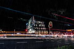trails (bjdewagenaar) Tags: photography photograph photographer photooftheday sony sonyalpha sonyphotographer sonyimages sonya77ii sonya sigma sigmalens wideangle street streetphotography night nightphotography dark lights trails lighttrails building architecture architecturephotography traffic rain clouds