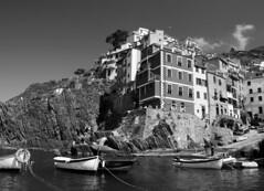 Riomaggiore - Cinque terre (Darea62) Tags: blackandwhite village sea boats travel liguria italy blackwhite bw biancoenero hill unesco harbor barche paese