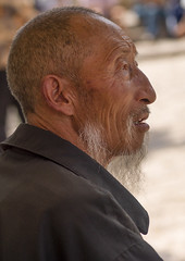 Old Man From Naxi Minority, Lijiang, Yunnan Province, China (Eric Lafforgue) Tags: a0007637 activeseniors adult adultsonly asia beard china chineseculture colorpicture day dayantown menonly naxi onemanonly onepeople oneperson oneseniormanonly onlymen portrait realpeople senioradult traditionalclothing travel unescoworldheritagesite vertical wisdom yunnan yunnanprovince lijiang