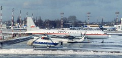SP-FNB and RA 27014 WAW 180293 (kitmasterbloke) Tags: waw warsaw warsawa lot polska poland 1993 ilyushin yakelov airport aircraft outdoor snow cold freezing aviation