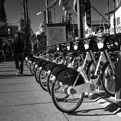 024693763987-106-Public Transportation-2-Black and White (Jim There's things half in shadow and in light) Tags: 2018 america lasvegas nevada november streetphotography transportation bicycle walking monochrome downtown blackandwhite tamron2470mmf28divcusdg2