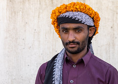 Portrait of a yemeni refugee wearing a floral crown on the head, Jizan Province, Addayer, Saudi Arabia (Eric Lafforgue) Tags: addayer adult arabia colorimage cultures decoration ethnography floralgarland flower flowercrown flowers horizontal indigenousculture jizanprovince ksa lookingatcamera males man marigold men middleeast middleeastern oneadultonly onemanonly oneperson orange photography plant portrait refugee saudiarabia saudi181941 tihama tradition travel tribal tribe waistup war yemeni sa