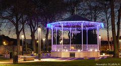 Bandstand with christmas lights (v.2018) (Alexandre D_) Tags: canon eos 70d tripod vanguard panorama city light lights christmas noel bandstand night nightsky longexposure nuit colors color colorful couleur colour colours nightphotography music kiosque france hautsdefrance nord pasdecalais bassinminier architecture history billymontigny led blue orange weihnachten outdoor outside nature navidad xmas arbre lightpainting 50mm 50mmf14 sigma50mmf14exhsm sky clouds atmosphere cityscape town illumination shadow sunset bluehour parc park yellow