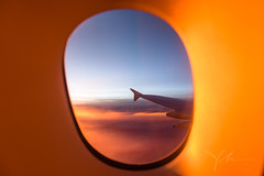 Mile-high-sunset-through-the-looking-glass.jpg (yobelprize) Tags: aircraft window altitude wing fly airline air looking plane jet sky aerialview view setting cloudscape sunset airplane aerial golden clouds vacation yobel transportation aviation sunrise flight travel yobelmuchang high space cloud milehigh tourism through trip
