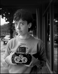 Lindsey with Stereo Camera 140416 (jimhairphoto) Tags: photographer street portrait streetlife streetstories théâtrederue portland oregon america pdx portlandnw remainsoftheday naturalworld 4x5project crown graphic camera mfg1963 4x5 ilford hp5 film blackandwhite blancetnoir schwarzweiss blancoynegro blancinegre siyahrebeyaz jimhairphoto