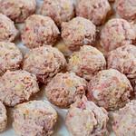 Raw meatballs on white background thumbnail