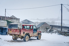 Santa's Sleigh - Happy Holidays To Everyone. (john lunt) Tags: santas sleigh landrover defender red pickup snowing snow whiteover cold freezing badweather farm farmyard farming agriculture agricultural buildings barns stone happyholidays happychristmas winter wintertime snowcovering cornish cornwall england uk britain englishwinter horizontal colour color landscape hdr tonemapped john lunt sony alphaa7r2 zeiss 55mmf18za primelens beautiful quiet peaceful peace tranquil tranquillity idyllic