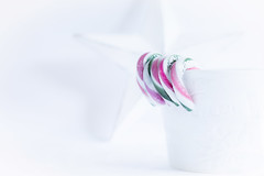 361/365: Life on the edge... (judi may) Tags: 365the2018edition 3652018 day361365 27dec18 highkey mug cup white star candycanes candy stilllife christmas festive tabletopphotography canon5d 50mm bokeh depthoffield dof