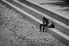 Thoughts (rdpe50) Tags: telephoto bw urban city man steps falsecreek vancouverbc
