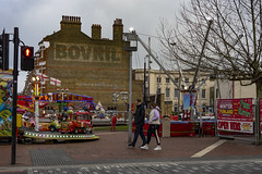 Brixton, Winter Funland (London Less Travelled) Tags: uk unitedkingdom britain england london southlondon city urban street suburb suburbs suburban suburbia brixton lambeth people fair funfair winter bovril ghostsign