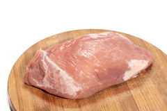 Slice of raw pork meat on the cutting board (wuestenigel) Tags: butcher fillet cut slice portion background meat fat bloody uncooked cook pork isolated white raw steak piece closeup cooking bone butchery muscle cow diet loin fresh food barbecue studio red cuisine freshness chop nutrition dinner beef protein sirloin ingredient