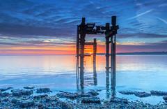 Dolphin Sunrise (nicklucas2) Tags: seascape beach lepe dolphin cloud lowtide isleofwight sea seaweed solent sun sunrise sunburst
