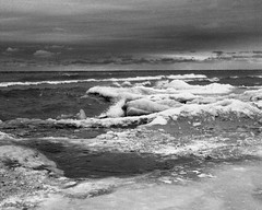Songs of Ice and Water #1 (azhukau) Tags: mamiyac220 tlr analog analogphotography analogue film filmphotography ilford hp5 outdoors ontario lakeontario lakescape ice icescape shore winter water lake nature sad mamiyasekor80mmf28 darkskys moody landscape orangefilter