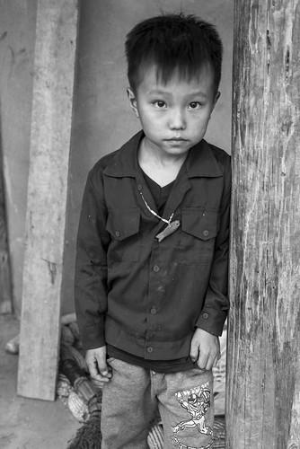 Hmong boy with fish pendant