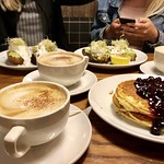 A Breakfast Table with Blueberry Pancakes and Avocado Toasts thumbnail