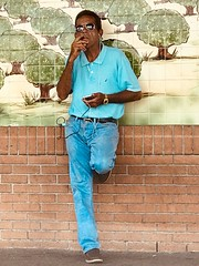 One leg ombré (LarryJay99 ) Tags: latino walls mural inspiredbylove man men guy guys dude male studly manly dudes handsome people virile bluejeans jeans smoking darkskin sidewalk candid unsuspecting unaware real