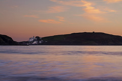 Burgh Island Hotel @ Dusk (Christian Hacker) Tags: burghislandhotel challaboroughbay sunset dusk water pinkclouds colourful coast coastal lowkey seascape canoneos50d tamron1750mm ocean sea agathachristie famous devon southcoast uk cokinfilter tranquil longexposure whitehouse bay evening lights cliffs reflections