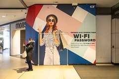 What's the Wi-Fi? (cookedphotos) Tags: 2018inpictures toronto ontario canon 5dmarkiv streetphotography eatoncentre shopping mall wifi typography model woman cellphone face funny 365project p3652018