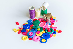 In Fashion Be bold and individual (Ian Johnston LRPS) Tags: buttons sewing thread needle tabletop art craft fashion bobbins thimble red yellow green blue pink purple