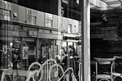 Reflections (Bury Gardener) Tags: monochrome mono burystedmunds bw blackandwhite britain suffolk streetphotography street streetcandids snaps strangers candid candids people peoplewatching folks nikond7200 nikon england eastanglia uk 2019 abbeygatestreet